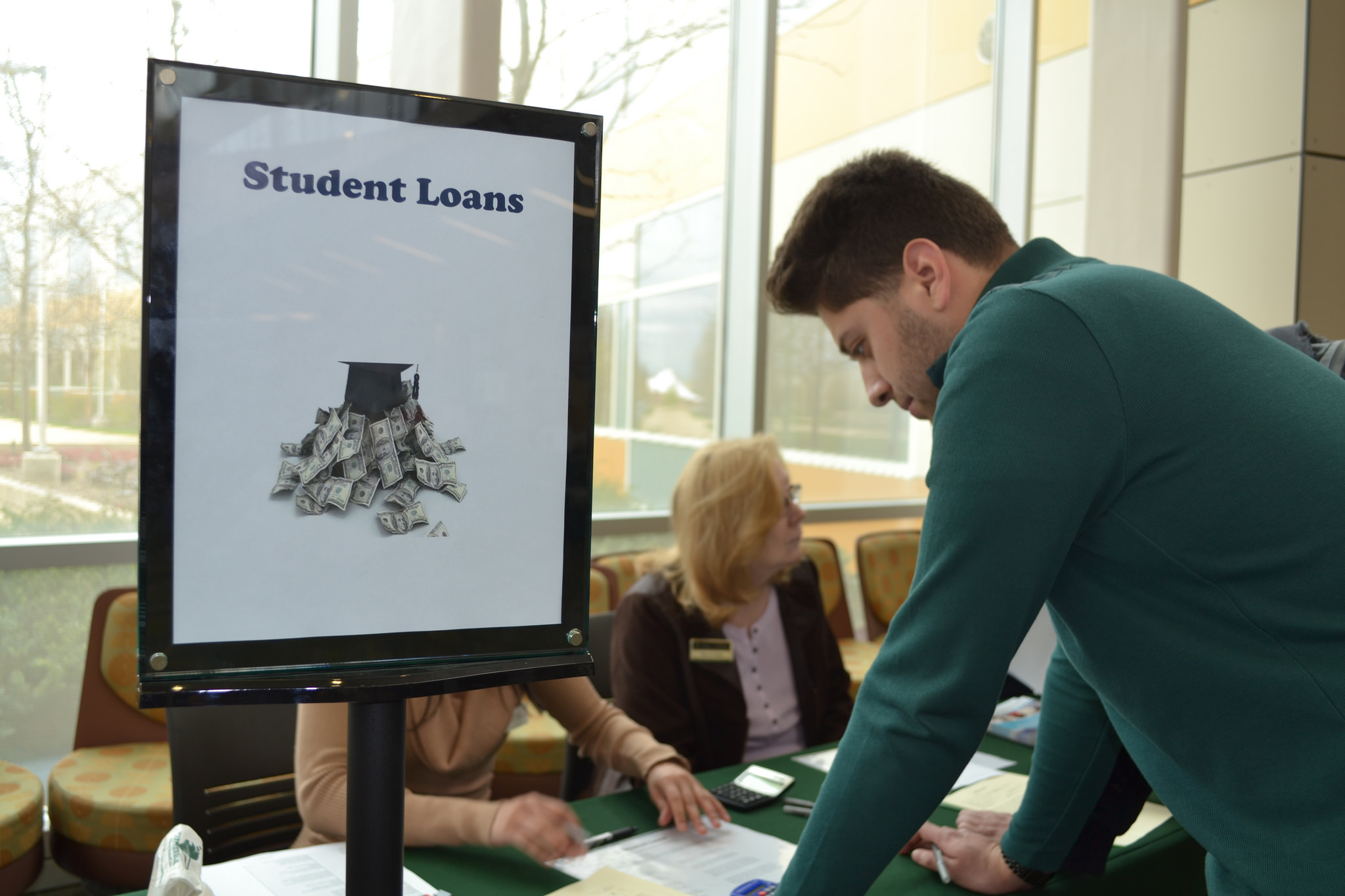 Image of man standing at a financial aid desk