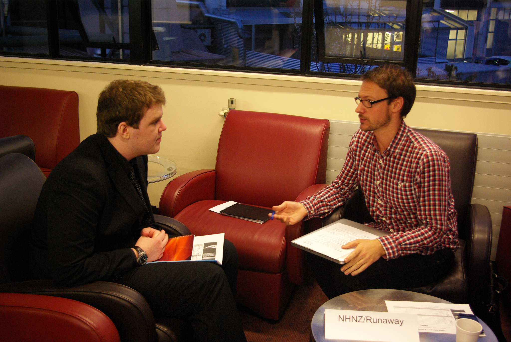 Image of two men during interview